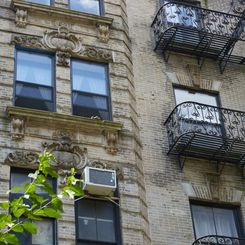building exterior with fire escapes